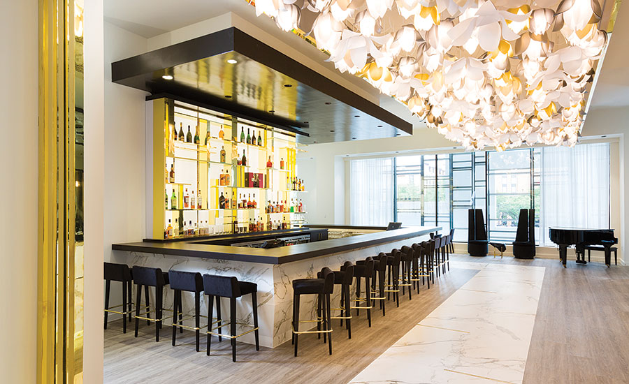 The marble aesthetic of dekton gives saks fifth avenue s for Aura world fusion cuisine