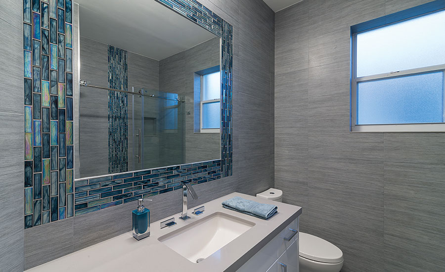 For a residential remodel a neutral palette of porcelain tile, glass ...