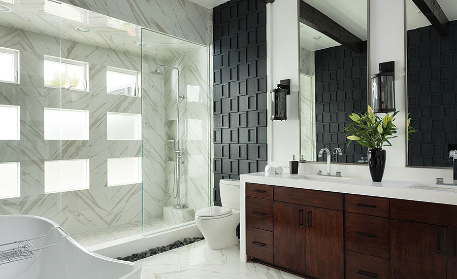 A Master Bathroom Is Transformed Using Plenty Of Natural Light And A Combination Of Tile River