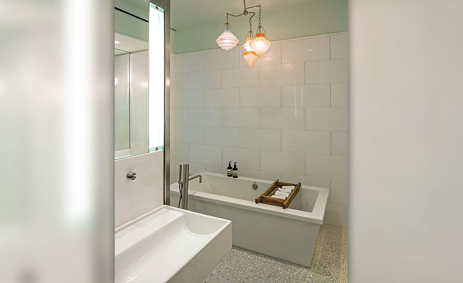 White Thassos marble on tub and shower walls