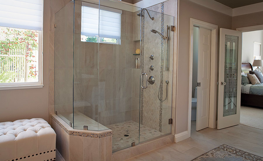 A Range Of Porcelain Glass And Mosaic Tile Create A Sophisticated Master Bath Design In A