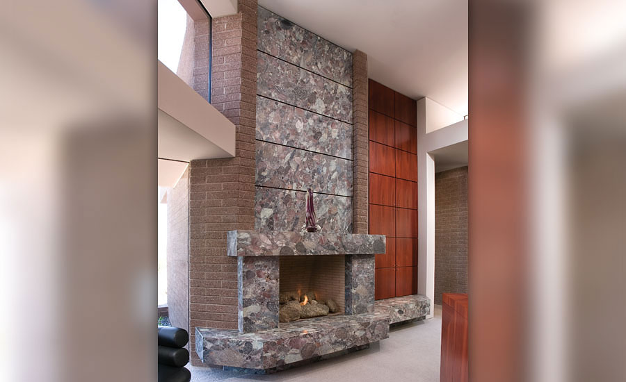 floor-to-ceiling stone fireplaces