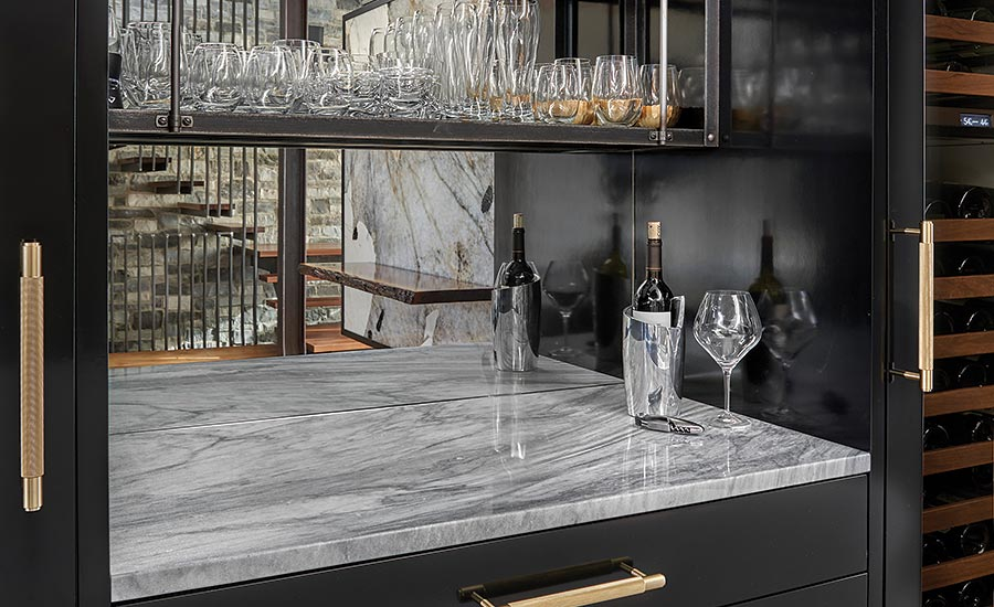 lighted bar in the dining area with White Shadow marble counter top