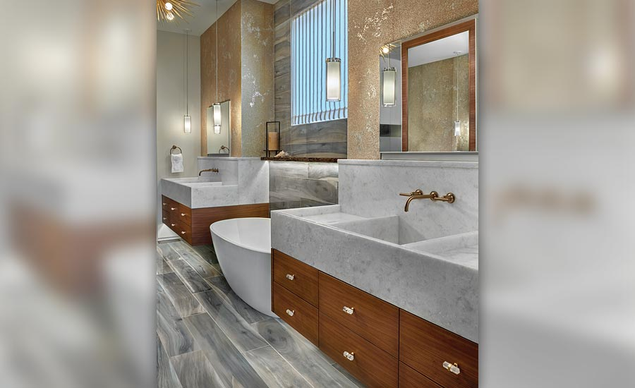 wooden cabinetry and Opal Calcite sinks in master bathroom