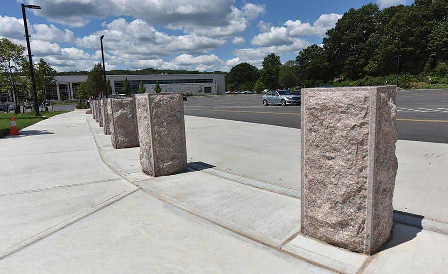 16-inch x 4-foot bollards that were custom made by Granites of America