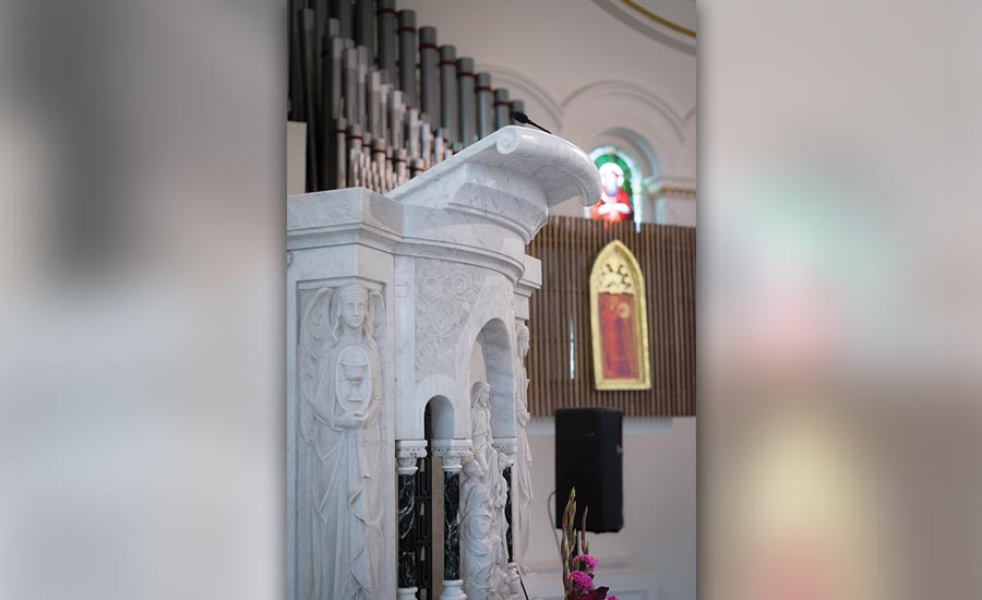 Marble book holder added to the existing historic pulpit