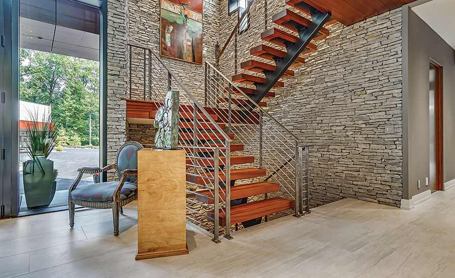 massive floor-to-ceiling stone accent wall up the stairway
