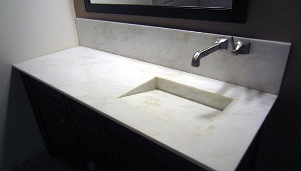 Custom marble granite running the gamut of stone for Quartz integrated sink