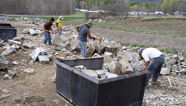 workers split material by hand as needed